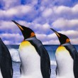 Emperor's four penguins on sea wave background - Stock Photo