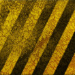 Old grungy yellow hazard stripes wallpaper — Stock Photo