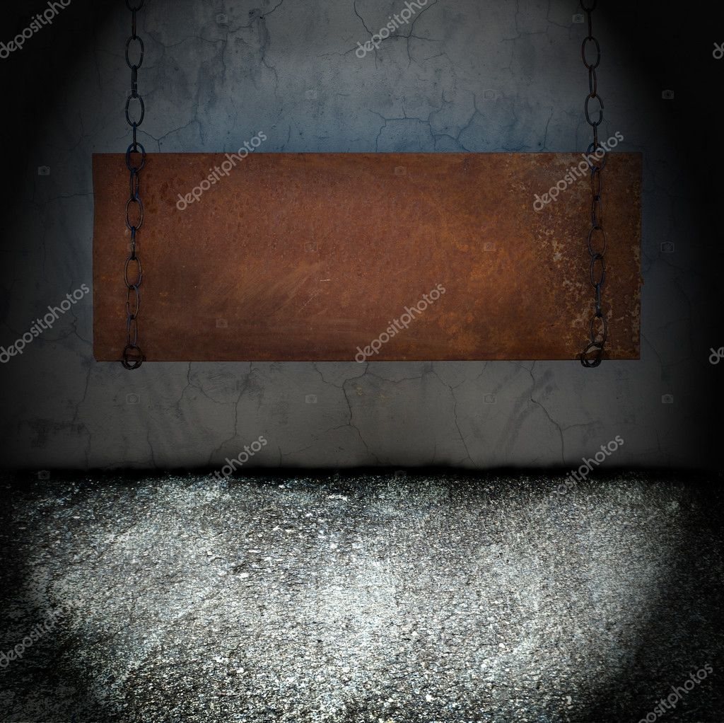 Metal banner hanging in a dark grungy room — Stock Photo #4949248