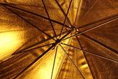 Golden umbrella — Stock Photo