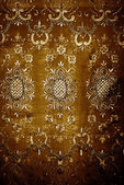 Grunge golden floral texture fabric — Stock Photo