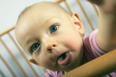Baby shows tongue — Stock Photo