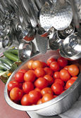 Tomatoes in a stainless steel colander — Stock Photo