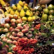 Fruit stand at the Boqueria market - Stock Photo
