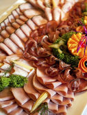 Buffet plate with different kinds of ham — 图库照片