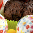 Chocolate muffin with easter eggs — Stock Photo