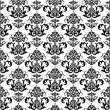 Seamless black and white floral wallpaper — Stock Vector
