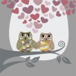 Love is in the air for two owls — Stock Vector
