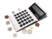 Biały biznes elektroniczny obliczać ono z monet — Zdjęcie stockowe