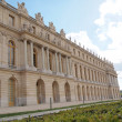 Castle of Versaille frontage with blue sky in the background — Stock Photo