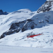 Vehicles helicopter at Jungfrau in Switzerland mountain — Stockfoto #4314604