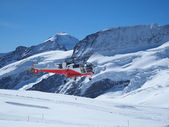 Flying Helicopter at Jungfrau Top of Europe in the Swiss Mountai — Stock Photo