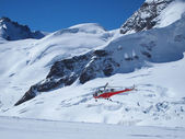 Vehicles helicopter at Jungfrau in Switzerland mountain — Stock Photo