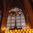 Candle and stained window — Lizenzfreies Foto