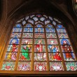 Stained window at a church in Brussels - Stock Photo