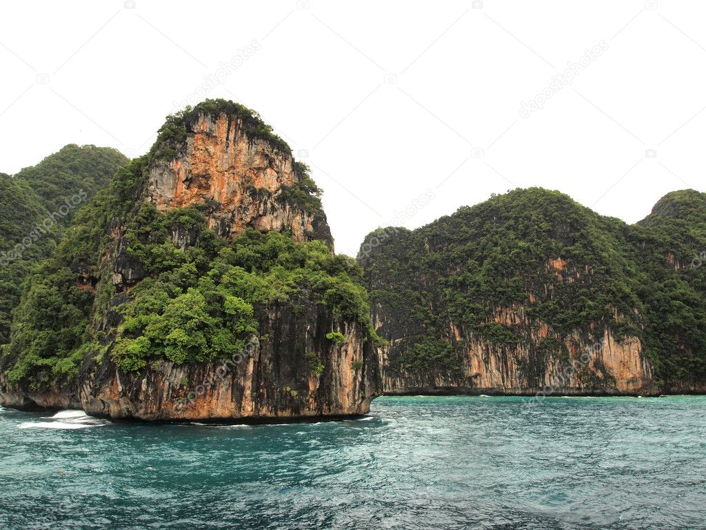 The Phi Phi Islands are located in Thailand , between the large island of Phuket and the western Andaman Sea coast of the mainland. The islands are administrati  Stock Photo #4971024