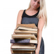 Woman carrying a heavy stack of books — Stock Photo