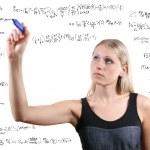 Woman writes mathematical equations — Stock Photo