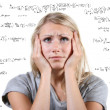 Desperate woman with many mathematical equations around her — Stock Photo #4118722