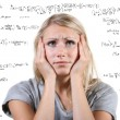 Desperate woman with many mathematical equations around her — Stock Photo