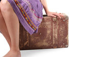 Woman sitting on old suitcase — Stok fotoğraf
