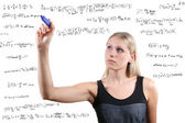 Woman writes mathematical equations — Stock Photo