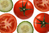 Tomatoes and cucumbers on white background — Stock Photo