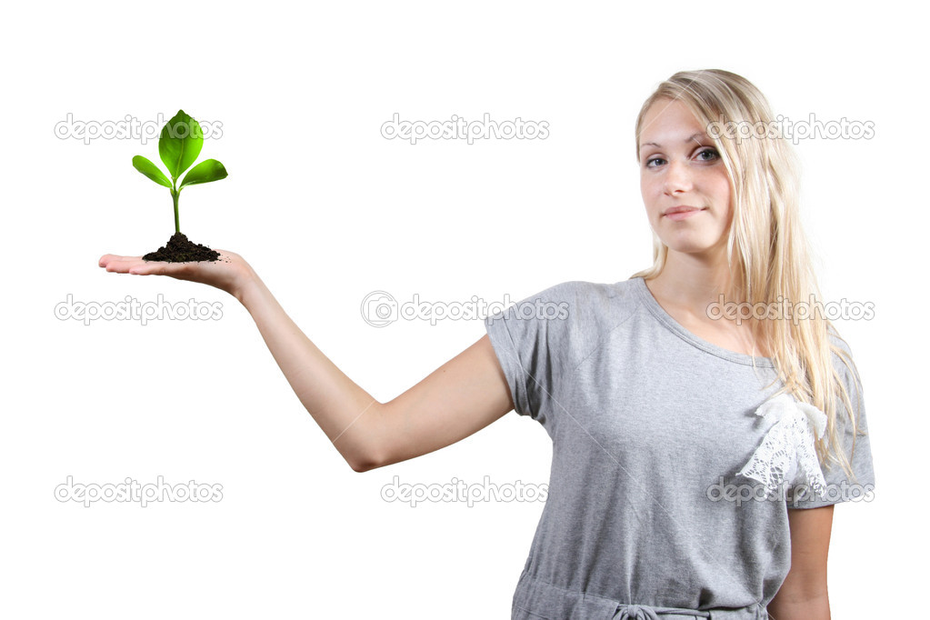 Eco concept: beautiful woman with green plant in her palm — Stock Photo #4118714