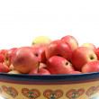 Red apples in a bowl isolated on white background — Stok fotoğraf