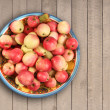 Apples in a bowl on wooden background — Stock Photo