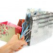 Stock Photo: Hand hold four gift bags