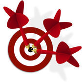 Target with three red darts in center — Stock Photo