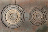Ancient kitchen stove rings — Stock Photo