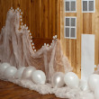 Holiday home decoration with white balloons — Stock Photo
