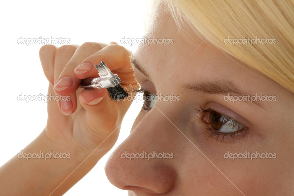 A young girl puts on make up — Stock Photo #4408256