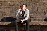 Young guy with alcohol and nicotine — Stock Photo