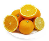 Lemon and oranges on a plate — Stock Photo