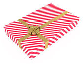Gift box, striped, with ribbons, isolated on white — Stock Photo