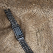Women shinning watch on burlap — Stock Photo #4492459