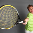 Stock Photo: Young attractive tennis player
