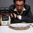 Stock Photo: Portrait of disappointed businessmwith saw