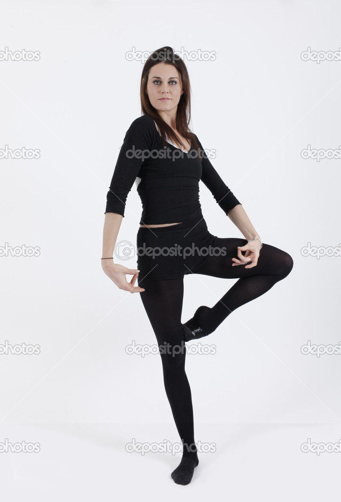 Young gymnast in black looking at the camera  Stock Photo #4946436