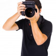 Young male photograher at studio, isolated on white — Stock Photo