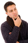 Pensive young casual man dressed with winter clothes, isolated o — Stock Photo