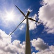 Wind turbine over a cloud filled blue sky, alternative energy so — Stock Photo