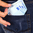 Man Wearing Jeans with Money in Back Pocket - Foto Stock
