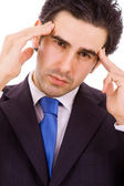 Business man in agony with a headache — Stock Photo