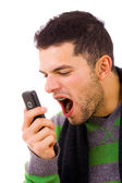 Angry young man shouting at the phone — Stock Photo