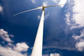 Windmill against a blue sky and clouds, alternative energy sourc — Stock Photo