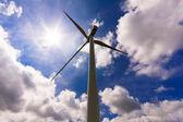 Wind turbine over a cloud filled blue sky, alternative energy so — Stock Photo